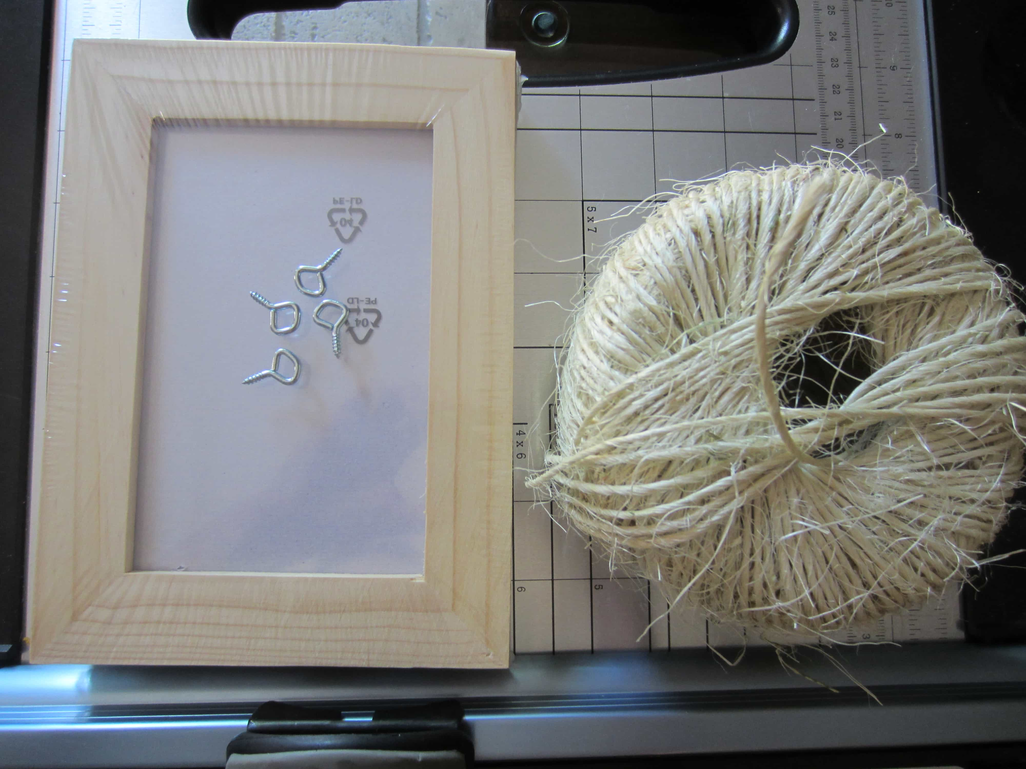 the pictures speak for themselves but all you need to do is to screw each picture frame eyelet into the wooden frame by hand in the desired area