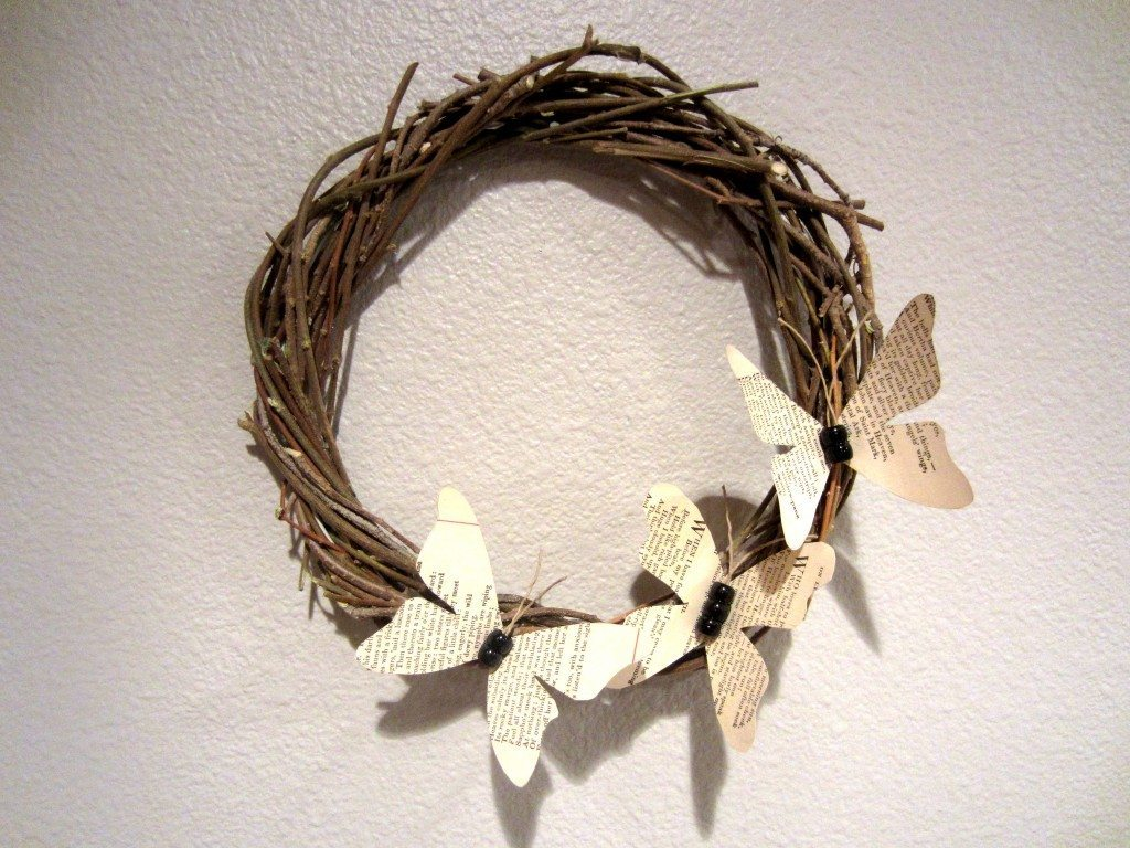 How to make a Recycled Book Page Butterfly Wreath out of pages from a damaged book and branches.