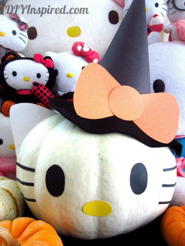 A close up of a stuffed Hello Kitty pumpkin
