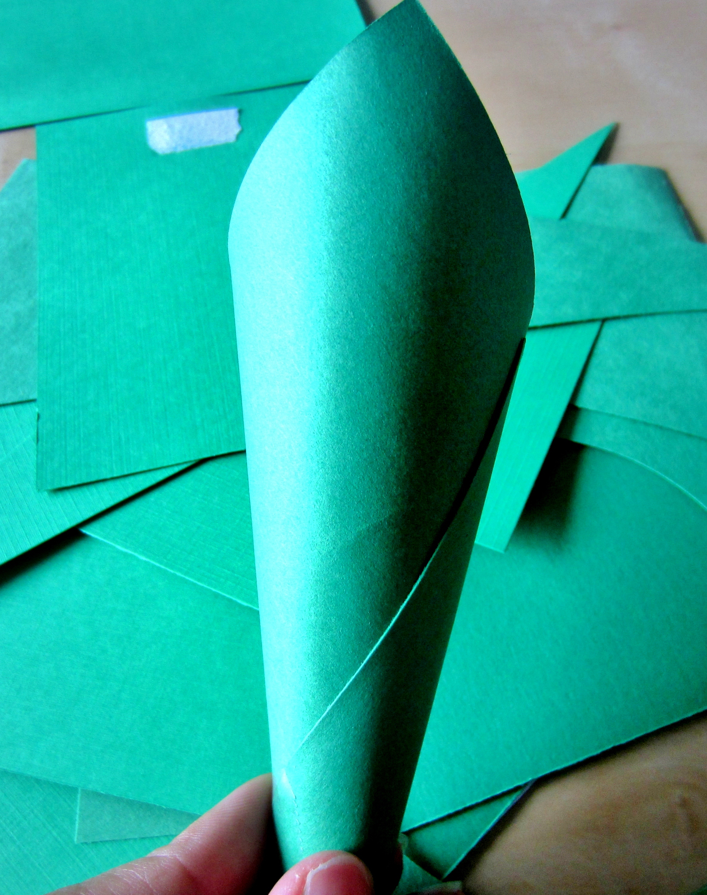 How to make scrapbook using recycled materials - Cut Out Several Triangles In Varying Lengths And Sizes