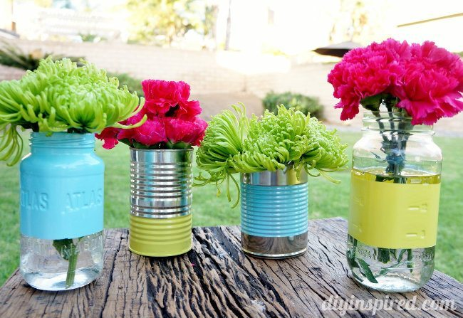 Mason Jar and tin can centerpiece with pink and green fresh flowers.