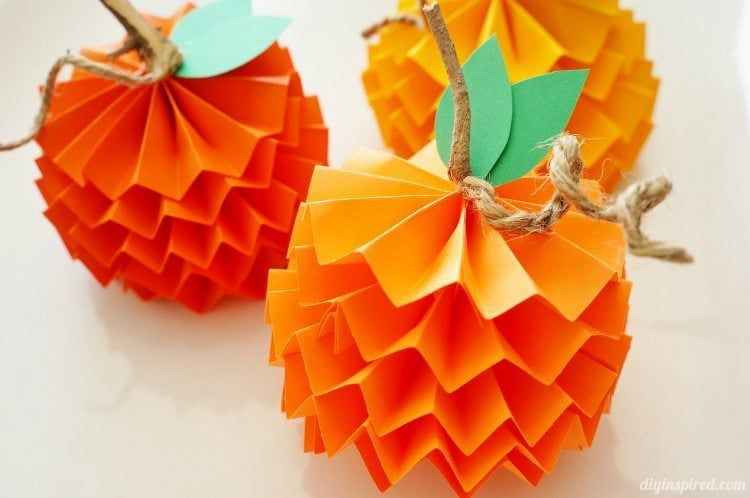 http://www.diyinspired.com/how-to-make-paper-pumpkins-for-fall/