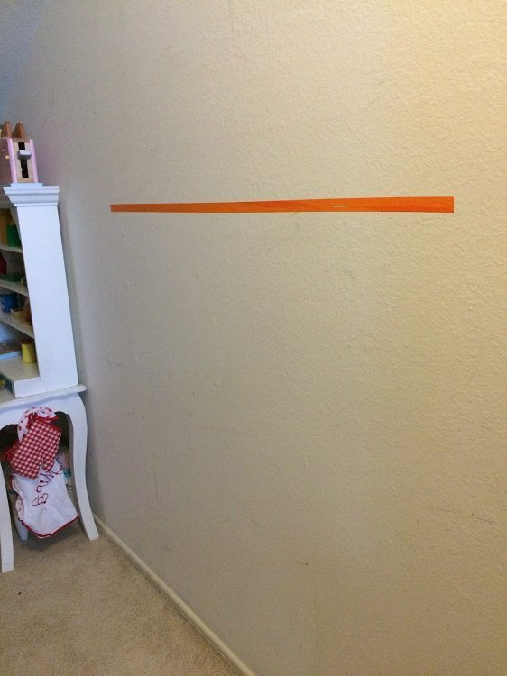 Easy Way to Hang Pictures with Two Hooks (2)