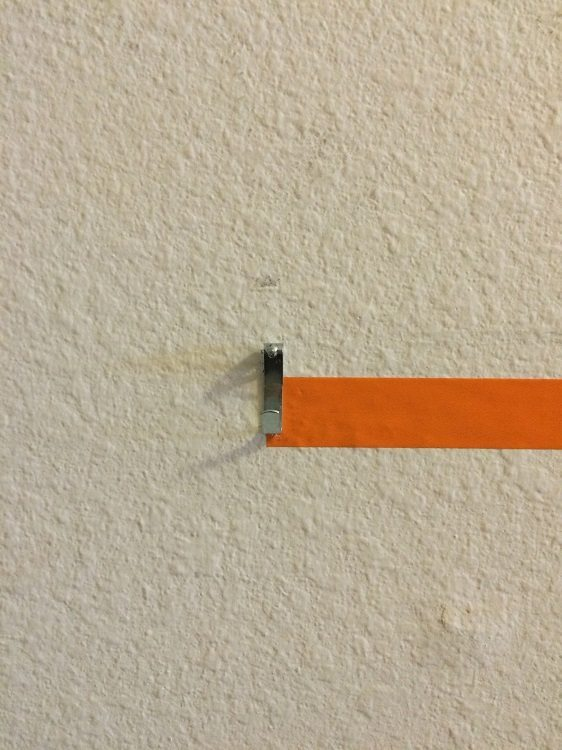 Easy Way to Hang Pictures with Two Hooks (3)