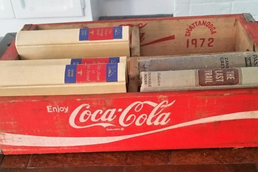Repurposed Coca Cola Boxes as Book Storage
