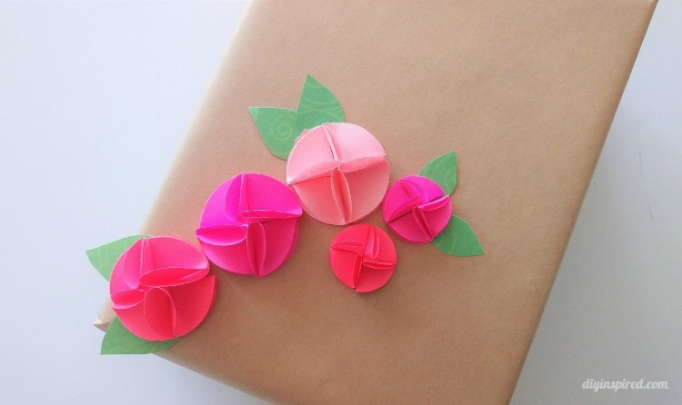 Easy circle punch paper flowers diy inspired you can make these with any sized circle punch for larger ones you can even layer the flowers just make sure the first layer of petals is flattened more mightylinksfo