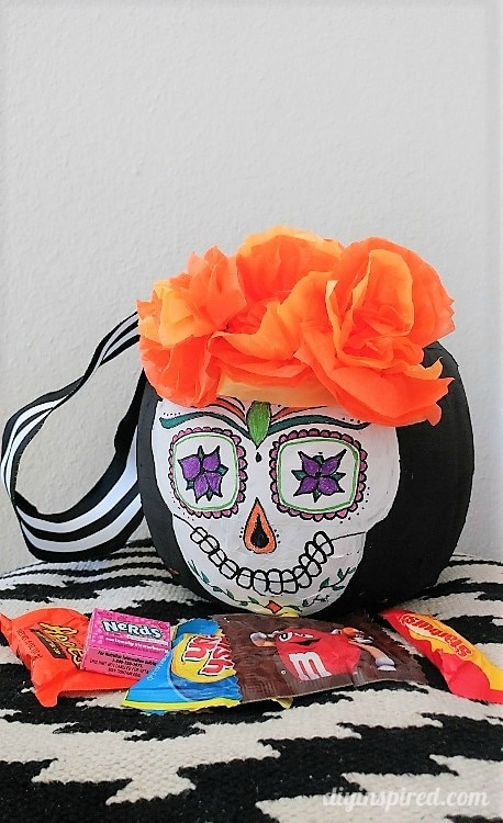 Day of the dead paper mache trick or treat pail diy inspired for more halloween and dia de los muertos diys you may like mightylinksfo